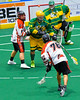 Onondaga Redhawks Lee Nanticoke (76) shoots and scores against the Newtown Golden Eagles in Can-Am Box Lacrosse action at the Onondaga Nation Arena near Nedrow, New York on Saturday, July 29, 2016.  Newtown won 10-7.