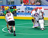 Newtown Golden Eagles Rudi Geroge (86) shoots and scores on Onondaga Redhawks goalie Edmund Cathers (1) in Can-Am Box Lacrosse action at the Onondaga Nation Arena near Nedrow, New York on Saturday, July 29, 2016.  Newtown won 10-7.