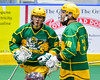 Newtown Golden Eagles Rudi Geroge (86) gets congratulated by Morgan Montour (88) for his goal against the Onondaga Redhawks in Can-Am Box Lacrosse action at the Onondaga Nation Arena near Nedrow, New York on Saturday, July 29, 2016.  Newtown won 10-7.