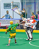 Onondaga Redhawks goalie Edmund Cathers (1) passing the ball against over Newtown Golden Eagles Morgan Montour (86) in Can-Am Box Lacrosse action at the Onondaga Nation Arena near Nedrow, New York on Saturday, July 29, 2016.  Newtown won 10-7.