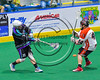 Onondaga Redhawks Brian Phillips Jr. (44) tries to block a shot by Rochester River Monsters Adam Pulver (32) in Can-Am Box Lacrosse action at the Onondaga Nation Arena near Nedrow, New York on Sunday, April 23, 2017.  Onondaga won 13-5.