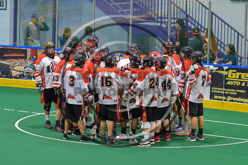 Onondaga Redhawks huddle up before playing the Rochester River Monsters in a Can-Am Box Lacrosse game at the Onondaga Nation Arena near Nedrow, New York on Sunday, April 23, 2017.