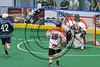 Rochester River Monsters Cameron Gebhardt (42) scores a goal on Onondaga Redhawks goalie Dave Jones (1) in Can-Am Box Lacrosse action at the Onondaga Nation Arena near Nedrow, New York on Sunday, April 23, 2017.  Onondaga won 13-5.