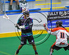 Rochester River Monsters CJ Fleming (62) being defended by Onondaga Redhawks Adam Yee (11) in Can-Am Box Lacrosse action at the Onondaga Nation Arena near Nedrow, New York on Sunday, April 23, 2017.  Onondaga won 13-5.