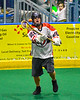 Onondaga Redhawks Matt Noble (20) passing the ball against the Newtown Golden Eagles in Can-Am Box Lacrosse action at the Onondaga Nation Arena near Nedrow, New York on Sunday, April 28, 2019.  Onondaga won 8-6.