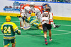 Newtown Golden Eagles Lyndon Stevens (89) scores a goal against Onondaga Redhawks goalie Dave Mathers (1) in Can-Am Box Lacrosse action at the Onondaga Nation Arena near Nedrow, New York on Sunday, April 28, 2019.  Onondaga won 8-6.