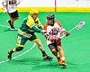 Onondaga Redhawks Junior Bucktooth (24) avoiding a check by a Newtown Golden Eagles defender in Can-Am Box Lacrosse action at the Onondaga Nation Arena near Nedrow, New York on Sunday, April 28, 2019.  Onondaga won 8-6.