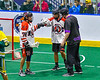 Onondaga Redhawks Wade Bucktooth (19) congratulates Lee Nanticoke (76) on his goal against the Newtown Golden Eagles in Can-Am Box Lacrosse action at the Onondaga Nation Arena near Nedrow, New York on Sunday, April 28, 2019.  Onondaga won 8-6.
