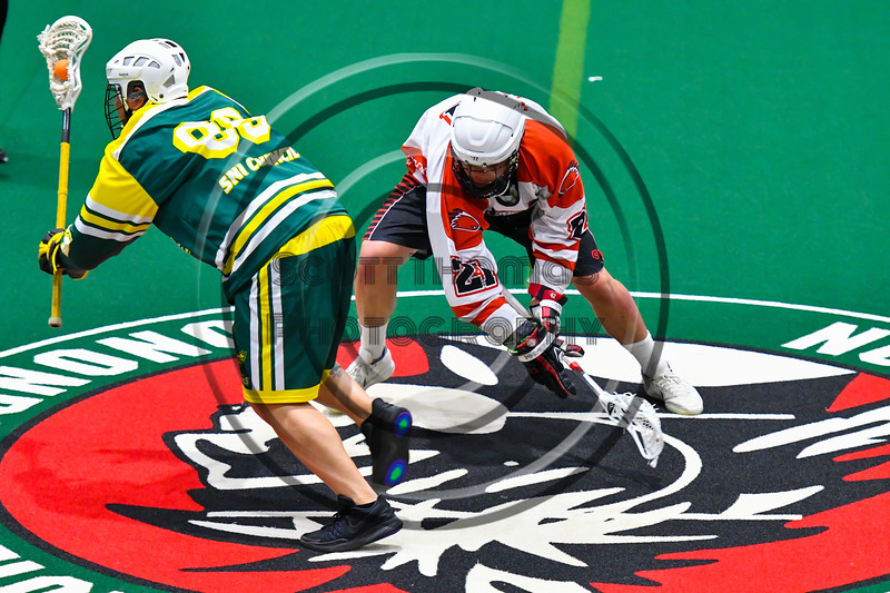 Onondaga Redhawks Percy Booth (21) looses the face-off to Newtown Golden Eagles Marve Curry (88) in Can-Am Box Lacrosse action at the Onondaga Nation Arena near Nedrow, New York on Sunday, April 28, 2019.  Onondaga won 8-6.