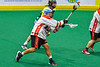 Onondaga Redhawks Leland Powless (7) fires the ball at the Newtown Golden Eagles net in Can-Am Box Lacrosse action at the Onondaga Nation Arena near Nedrow, New York on Sunday, April 28, 2019.  Onondaga won 8-6.