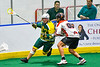 Onondaga Redhawks Bill O'Brien (96) defending against Newtown Golden Eagles Marve Curry (88) in Can-Am Box Lacrosse action at the Onondaga Nation Arena near Nedrow, New York on Sunday, April 28, 2019.  Onondaga won 8-6.