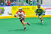 Onondaga Redhawks Leland Powless (7) running with the ball against the Newtown Golden Eagles in Can-Am Box Lacrosse action at the Onondaga Nation Arena near Nedrow, New York on Sunday, April 28, 2019.  Onondaga won 8-6.