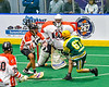 Newtown Golden Eagles Lucas Beaver (67) shoots and scores on Onondaga Redhawks goalie Dave Mathers (1) in Can-Am Box Lacrosse action at the Onondaga Nation Arena near Nedrow, New York on Sunday, April 28, 2019.  Onondaga won 8-6.