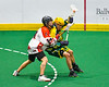 Onondaga Redhawks Gerald Johnson (14) defending against Newtown Golden Eagles Lucas Beaver (67) in Can-Am Box Lacrosse action at the Onondaga Nation Arena near Nedrow, New York on Sunday, April 28, 2019.  Onondaga won 8-6.