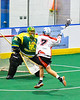 Onondaga Redhawks Leland Powless (7) driving to the Newtown Golden Eagles net in Can-Am Box Lacrosse action at the Onondaga Nation Arena near Nedrow, New York on Sunday, April 28, 2019.  Onondaga won 8-6.