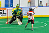 Onondaga Redhawks Lee Nanticoke (76) setting up a shot against Newtown Golden Eagles goalie Mason Junes (30) in Can-Am Box Lacrosse action at the Onondaga Nation Arena near Nedrow, New York on Sunday, April 28, 2019.  Onondaga won 8-6.