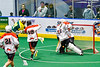 Onondaga Redhawks goalie Dave Mathers (1) makes a save against Newtown Golden Eagles Marve Curry (88) in Can-Am Box Lacrosse action at the Onondaga Nation Arena near Nedrow, New York on Sunday, April 28, 2019.  Onondaga won 8-6.