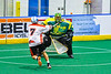 Onondaga Redhawks Leland Powless (7) fires the ball at  Newtown Golden Eagles goalie Mason Junes (30) in Can-Am Box Lacrosse action at the Onondaga Nation Arena near Nedrow, New York on Sunday, April 28, 2019.  Onondaga won 8-6.