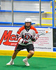Onondaga Redhawks Percy Booth (21) with the ball against the Newtown Golden Eagles in Can-Am Box Lacrosse action at the Onondaga Nation Arena near Nedrow, New York on Sunday, April 28, 2019.  Onondaga won 8-6.