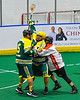 Onondaga Redhawks Edmund Cathers (10) battling for the ball against a Newtown Golden Eagles player in Can-Am Box Lacrosse action at the Onondaga Nation Arena near Nedrow, New York on Sunday, April 28, 2019.  Onondaga won 8-6.
