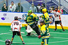 Onondaga Redhawks Lee Nanticoke (76) scores a goal against Newtown Golden Eagles goalie Mason Junes (30) in Can-Am Box Lacrosse action at the Onondaga Nation Arena near Nedrow, New York on Sunday, April 28, 2019.  Onondaga won 8-6.