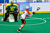 Onondaga Redhawks Leland Powless (7) lining up a shot against Newtown Golden Eagles goalie Mason Junes (30) in Can-Am Box Lacrosse action at the Onondaga Nation Arena near Nedrow, New York on Sunday, April 28, 2019.  Onondaga won 8-6.