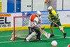 Newtown Golden Eagles Marve Curry (88) scores a goal against Onondaga Redhawks goalie Dave Mathers (1) in Can-Am Box Lacrosse action at the Onondaga Nation Arena near Nedrow, New York on Sunday, April 28, 2019.  Onondaga won 8-6.
