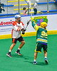 Onondaga Redhawks Leland Powless (7) passing the ball against Newtown Golden Eagles Kaine Kettle (21) in Can-Am Box Lacrosse action at the Onondaga Nation Arena near Nedrow, New York on Sunday, April 28, 2019.  Onondaga won 8-6.