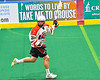 Onondaga Redhawks Percy Booth (21) running with the ball against the Newtown Golden Eagles in Can-Am Box Lacrosse action at the Onondaga Nation Arena near Nedrow, New York on Sunday, April 28, 2019.  Onondaga won 8-6.