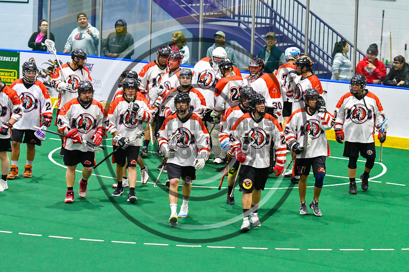 Onondaga Redhawks break the pre-game huddle before playing the Newtown Golden Eagles in a Can-Am Box Lacrosse game at the Onondaga Nation Arena near Nedrow, New York on Sunday, April 28, 2019.