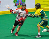 Onondaga Redhawks Brian Phillips Jr. (44) being defended by Newtown Golden Eagles Dennis Romesitter (17) in Can-Am Box Lacrosse action at the Onondaga Nation Arena near Nedrow, New York on Sunday, April 28, 2019.  Onondaga won 8-6.
