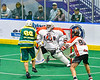 Onondaga Redhawks goalie Dave Mathers (1) tracking the ball as Newtown Golden Eagles Marve Curry (88) attempts to score in Can-Am Box Lacrosse action at the Onondaga Nation Arena near Nedrow, New York on Sunday, April 28, 2019.  Onondaga won 8-6.