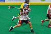 Onondaga Redhawks Leland Powless (7) leans into a shot at the Newtown Golden Eagles net in Can-Am Box Lacrosse action at the Onondaga Nation Arena near Nedrow, New York on Sunday, April 28, 2019.  Onondaga won 8-6.