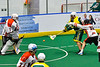 Newtown Golden Eagles Marve Curry (88) shoots the ball at Onondaga Redhawks goalie Dave Mathers (1) in Can-Am Box Lacrosse action at the Onondaga Nation Arena near Nedrow, New York on Sunday, April 28, 2019.  Onondaga won 8-6.