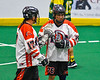 Onondaga Redhawks Vince Thomas (17) congratulates Lee Nanticoke (76) for his goal against the Newtown Golden Eagles in Can-Am Box Lacrosse action at the Onondaga Nation Arena near Nedrow, New York on Sunday, April 28, 2019.  Onondaga won 8-6.