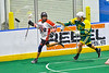 Onondaga Redhawks Lee Nanticoke (76) running with the ball being chased by Newtown Golden Eagles defender Keith Rice (10) in Can-Am Box Lacrosse action at the Onondaga Nation Arena near Nedrow, New York on Sunday, April 28, 2019.  Onondaga won 8-6.