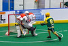 Onondaga Redhawks goalie Dave Mathers (1) makes a save against Newtown Golden Eagles Lucas Beaver (67) in Can-Am Box Lacrosse action at the Onondaga Nation Arena near Nedrow, New York on Sunday, April 28, 2019.  Onondaga won 8-6.