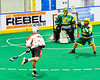 Onondaga Redhawks Leland Powless (7) fires the ball at Newtown Golden Eagles goalie Mason Junes (20) in Can-Am Box Lacrosse action at the Onondaga Nation Arena near Nedrow, New York on Sunday, April 28, 2019.  Onondaga won 8-6.