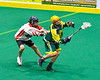 Onondaga Redhawks player checking Newtown Golden Eagles Lucas Beaver (67) in Can-Am Box Lacrosse action at the Onondaga Nation Arena near Nedrow, New York on Sunday, April 28, 2019.  Onondaga won 8-6.
