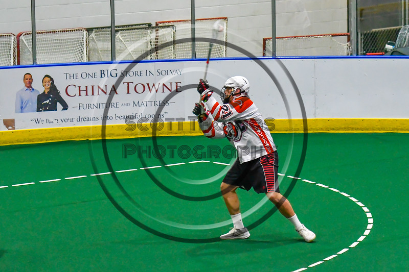 Onondaga Redhawks Percy Booth (21) leans into a shot at the Newtown Golden Eagles net in Can-Am Box Lacrosse action at the Onondaga Nation Arena near Nedrow, New York on Sunday, April 28, 2019.  Onondaga won 8-6.