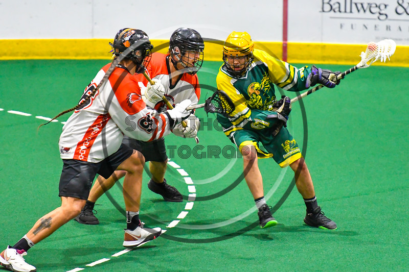 Newtown Golden Eagles Lucas Beaver (67) with the ball against Onondaga Redhawks defenders in Can-Am Box Lacrosse action at the Onondaga Nation Arena near Nedrow, New York on Sunday, April 28, 2019.  Onondaga won 8-6.