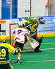 Newtown Golden Eagles goalie Mason Junes (30 makes a save against Onondaga Redhawks Leland Powless (7) in Can-Am Box Lacrosse action at the Onondaga Nation Arena near Nedrow, New York on Sunday, April 28, 2019.  Onondaga won 8-6.