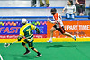Onondaga Redhawks Dave Limbouris (18) running with the ball against Newtown Golden Eagles Emerson Stevens (71) in Can-Am Box Lacrosse action at the Onondaga Nation Arena near Nedrow, New York on Sunday, April 28, 2019.  Onondaga won 8-6.