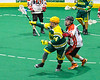 Newtown Golden Eagles Sid Steeprock (14) with the ball against the Onondaga Redhawks in Can-Am Box Lacrosse action at the Onondaga Nation Arena near Nedrow, New York on Sunday, April 28, 2019.  Onondaga won 8-6.