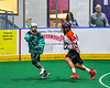 Rochester River Monsters Stephen Romas (15) passing the ball against Onondaga Redhawks Dustin Parker (84) in Can-Am Box Lacrosse action at the Onondaga Nation Arena near Nedrow, New York on Friday, May 10, 2019. Onondaga won 18-4.