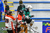 Onondaga Redhawks Cree Cathers (15) and Kevin Bucktooth (25) check Rochester River Monsters Jeff Geddis (11) in Can-Am Box Lacrosse action at the Onondaga Nation Arena near Nedrow, New York on Friday, May 10, 2019. Onondaga won 18-4.