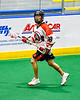 Onondaga Redhawks Gerald Johnson (18) with the ball against the Allegany Arrows in Can-Am Box Lacrosse action at the Onondaga Nation Arena near Nedrow, New York on Saturday, May 25, 2019. Allegany won 12-8.