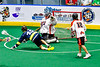 Allegany Arrows Jesse Jimerson (49) after scoring a goal against Onondaga Redhawks goalie Edmund Mathers (1) in Can-Am Box Lacrosse action at the Onondaga Nation Arena near Nedrow, New York on Saturday, May 25, 2019. Allegany won 12-8.