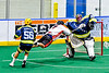 Onondaga Redhawks Mitch Laffin (7) is stopped by  Allegany Arrows goalie Craig Seneca (99) in Can-Am Box Lacrosse action at the Onondaga Nation Arena near Nedrow, New York on Saturday, May 25, 2019. Allegany won 12-8.