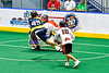 Allegany Arrows Jesse Jimerson (49) shoots and scores on Onondaga Redhawks goalie Edmund Mathers (1) in Can-Am Box Lacrosse action at the Onondaga Nation Arena near Nedrow, New York on Saturday, May 25, 2019. Allegany won 12-8.